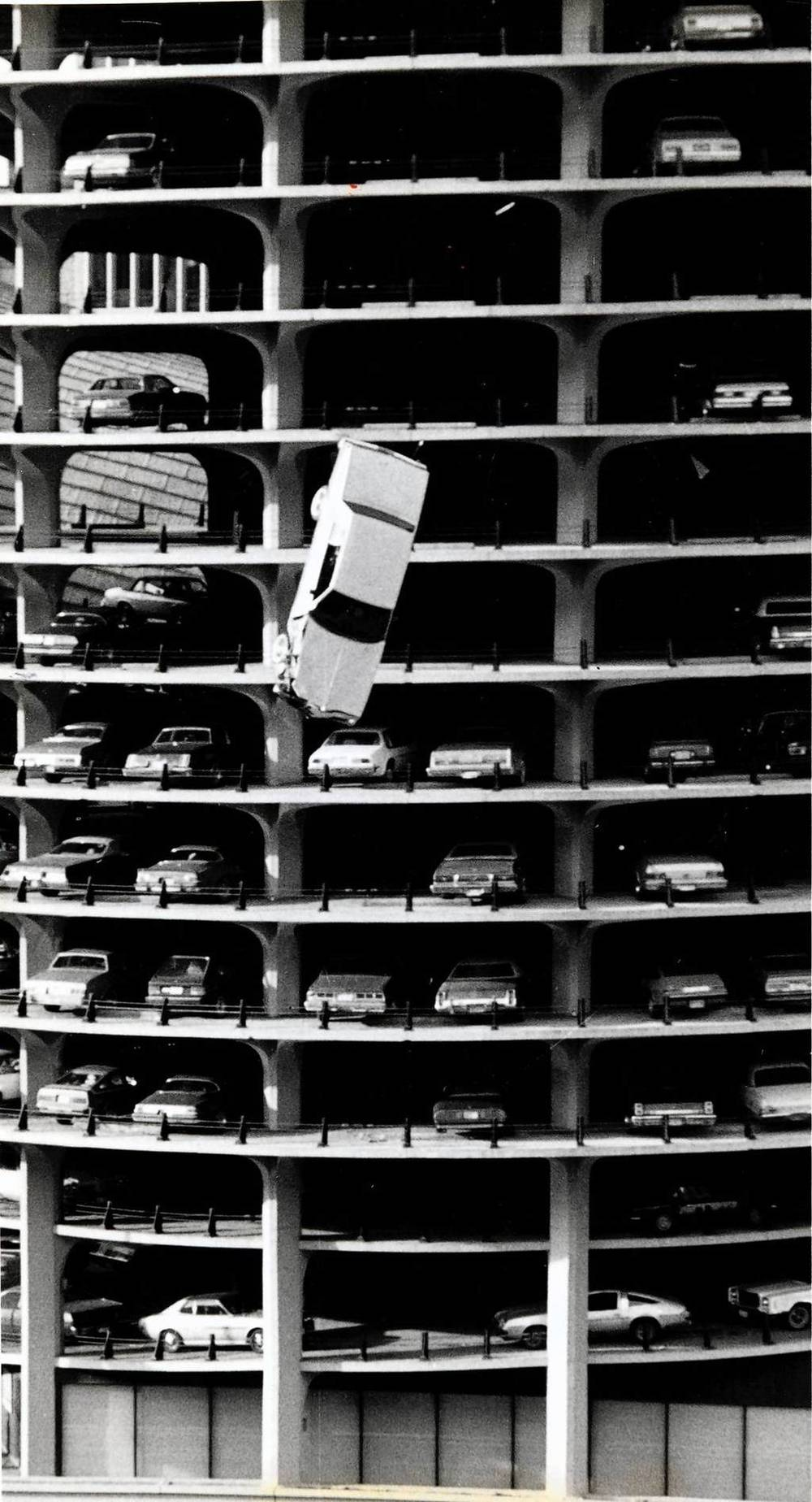 "wandrlust: Bertrand Goldberg's Marina City A sedan plunges from the 15th floor parking garage of Marina City into the Chicago River in 1979 during a movie stunt performed for a Steve McQueen film called ""The Hunter."""