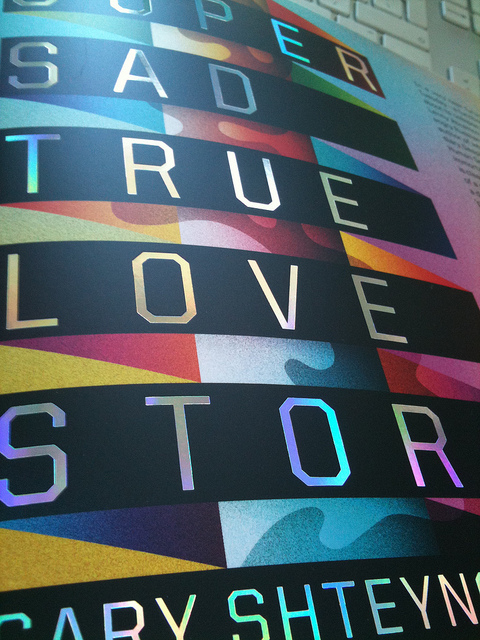 We have just heard today that SSTLS has been shortlisted for the British Book Design Awards 2011! Super Sad True Love Story on Flickr. Last year I commissioned La Boca to produce a beautiful and original cover for Gary Shteyngart's new novel… Comes complete with a rainbow foil on the type.