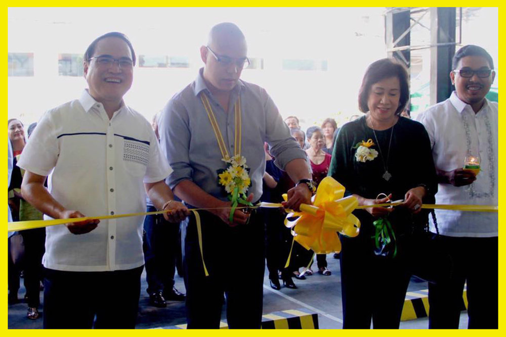 Cutting the ceremonial ribbon are La Union Governor Francisco Emmanuel Ortega III and Mrs. Geraldine Ortega, assisted by Rang-ay Bank President Ives Nisce and Vice-President Ives Jesus Nisce II.