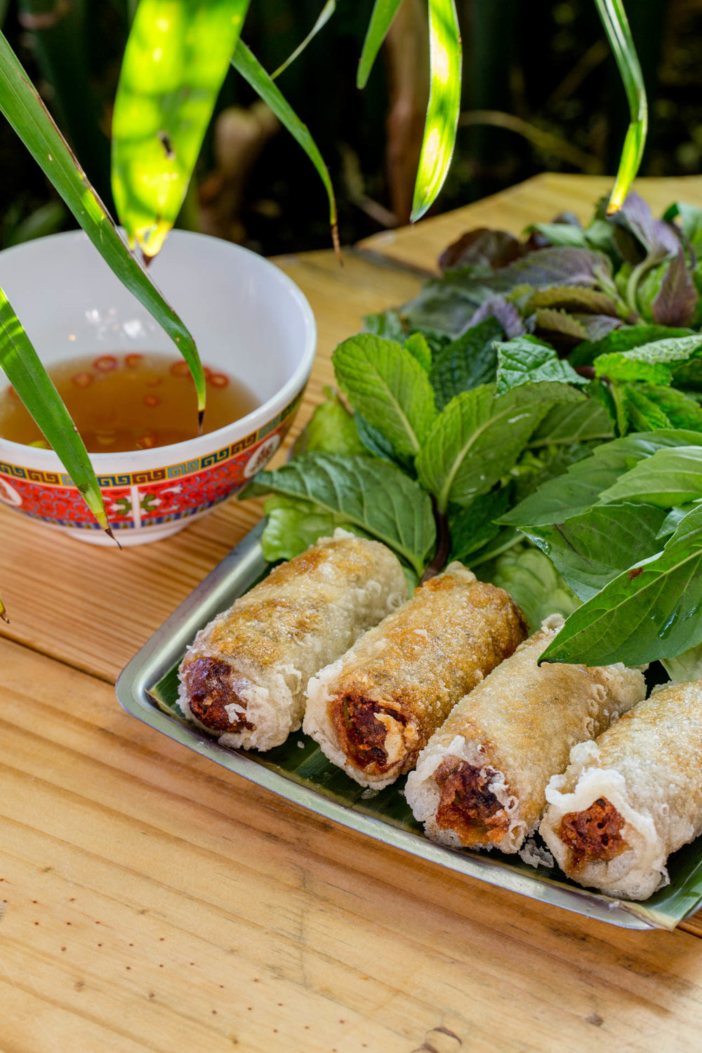 Lil' fried meat rolls by the bamboo.