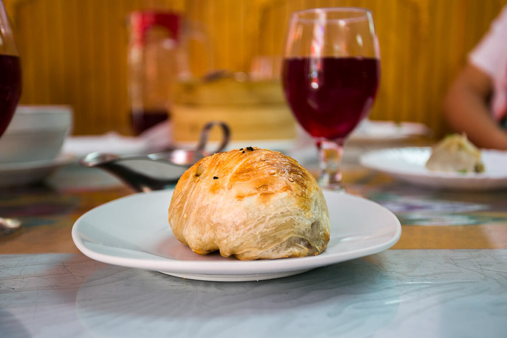 Another doughy lamb stuffed vehicle,  Samsa , has a golden flaky snap. When we asked for suggestions, our waitress suggested we try the sweet, fruity juice called  Compot.