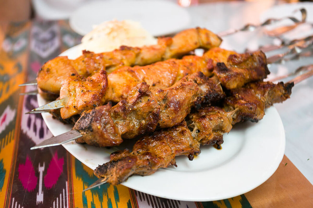 The juicy and immensely flavorful  lamb (foreground) and chicken (background) kebabs  on distinctive saber like skewers set the mood of the meal. This a meat forward cuisine.