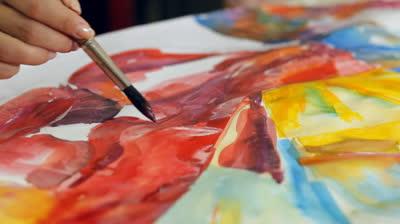 stock-footage-woman-artist-painting-watercolor-paints.jpg