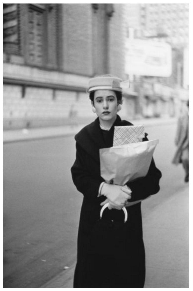 Woman on the street with parcels, N.Y.C. 1956