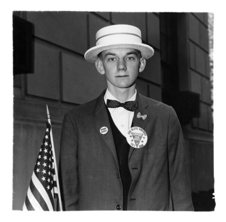 Boy with a straw hat waiting to march in a pro-war parade, N.Y.C. 1967