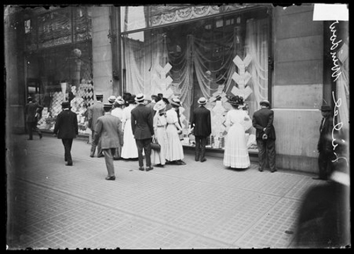 Pedestrians viewing Marshall Field & Company department store window display in the Loop community area of Chicago, Illinois, 1910.