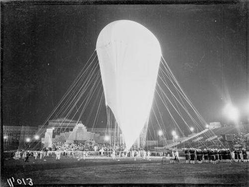 Crowds watch Auguste Piccard inflating the Stratosphere Balloon for flight in Soldier Field at the 1933 Chicago World's Fair, A Century of Progress International Exposition, Chicago, Illinois, 1933.