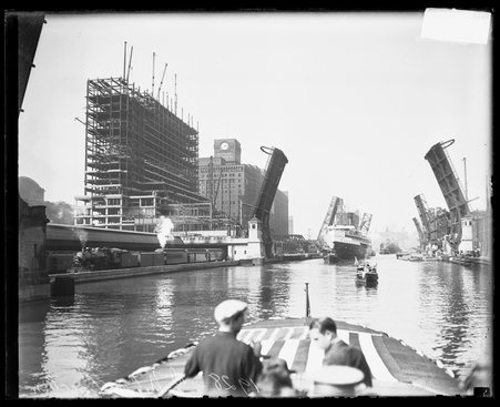 View from a boat on the Chicago River, showing the steel frame of the new Chicago Daily News building near 400 West Madison Street, Chicago, Illinois, 1928.