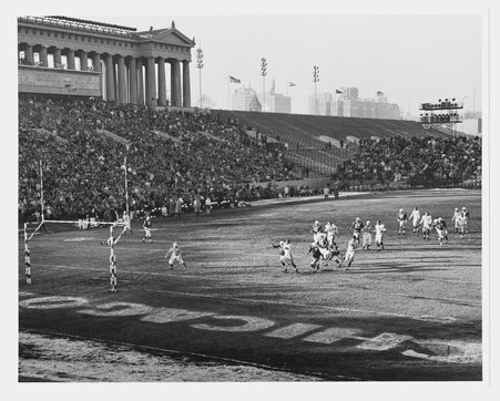 View of players running toward the endzone in a football game featuring the Chicago Cardinals versus Chicago Bears at Soldier Field, Chicago, Illinois, November 1959.