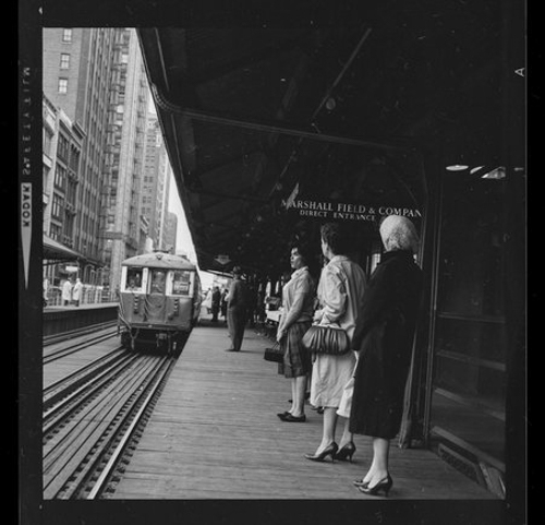 Chicago Transit Authority, CTA, elevated train platform at the Marshall FIeld and Company Department Store's direct entrance, Chicago, Illinois, circa 1930-1979.