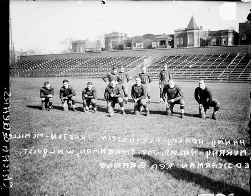 Members of the Chicago Bears football team at Weeghman Field (later renamed Wrigley Field), Chicago, Illinois; 1925. Included are: Bill Flechenstein, Harold Red Grange, George Halas, Frank Hanny, Ed Healey, McMillen, Murray, Joe Sternaman, Trafton, and Walquist.