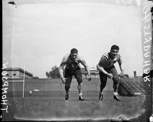 Chicago Bears football players Joe Stydahar (#13) and Russ Thompson at Wrigley Field, Chicago, Illinois, 1937.