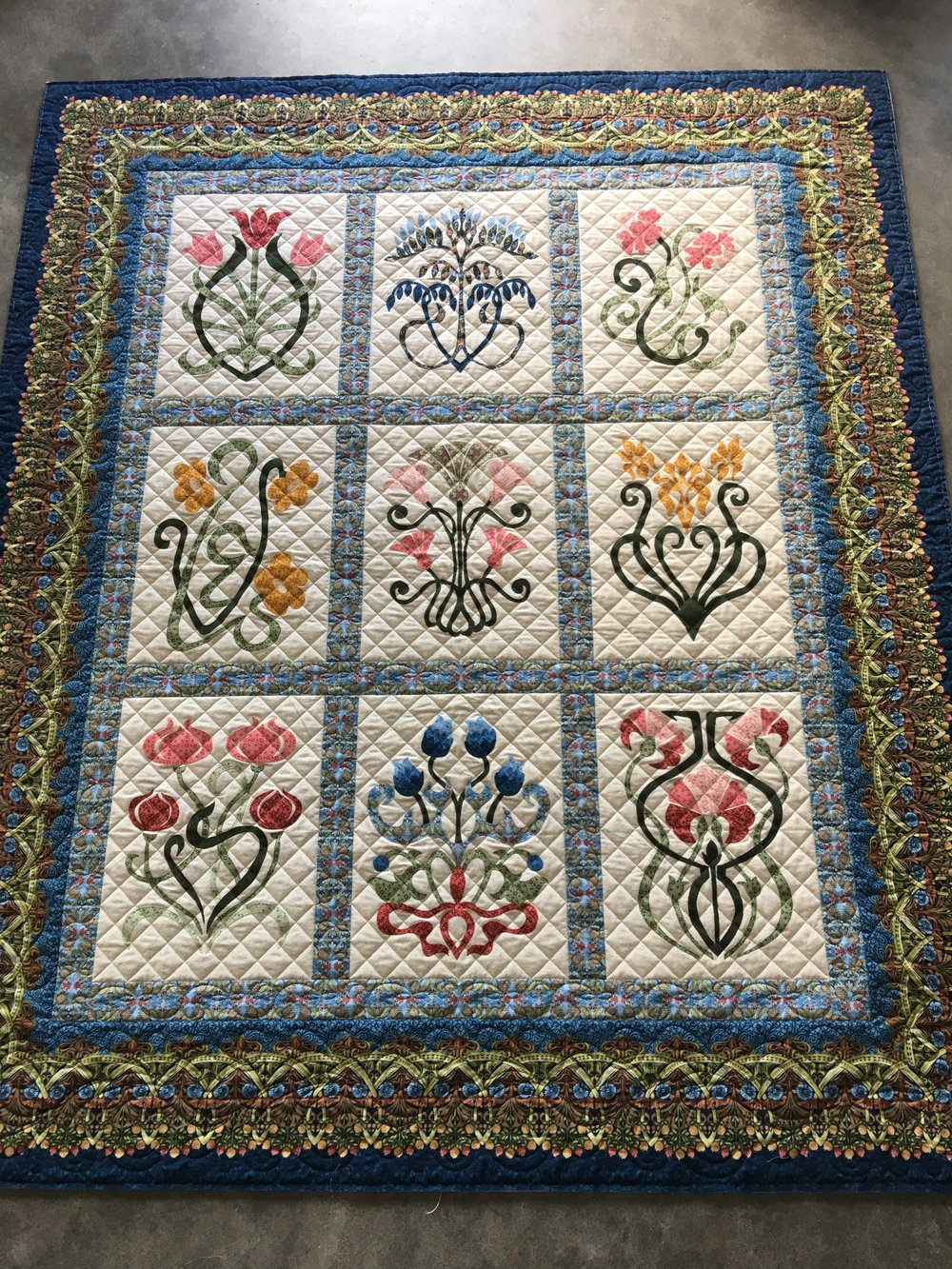Repeated block design with separate sashing & border designs
