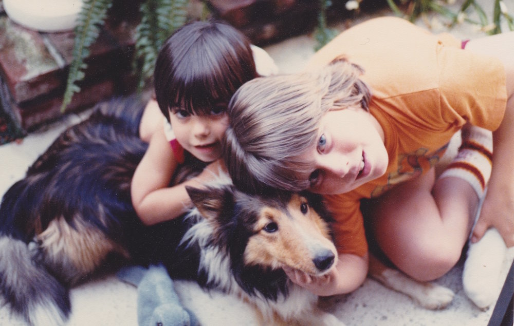 Amanda, her brother Chris and Prince their childhood dog