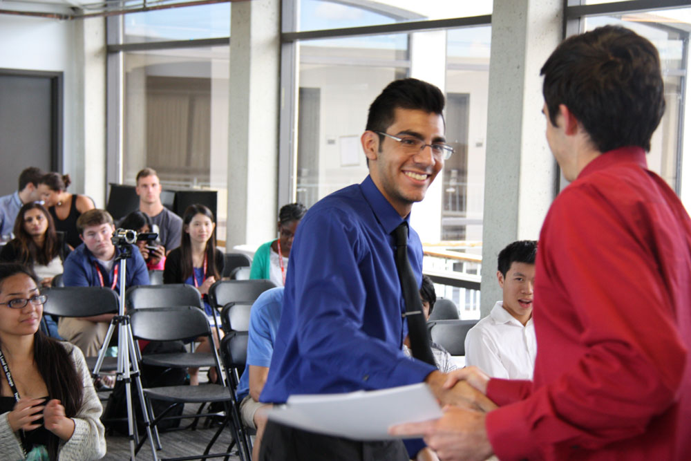 A Student Gets His Certificate of Completion