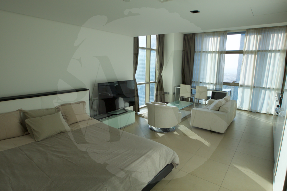 Sleeping area with king-sized bed and four pillows to ensure you have the best night's sleep!