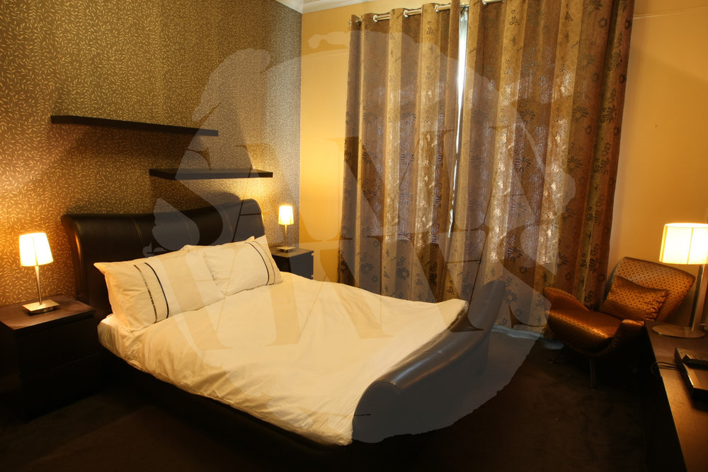 "The third bedroom has a kingsize bed as well as 40"" HDTV"