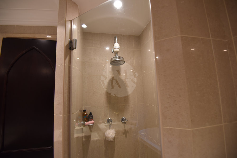 The bathroom is spacious with a luxurious bath and separate rain style shower  Show