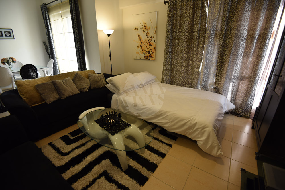 One of the sofas in the living room converts into an extremely comfortable bed with great views of Dubai Marina