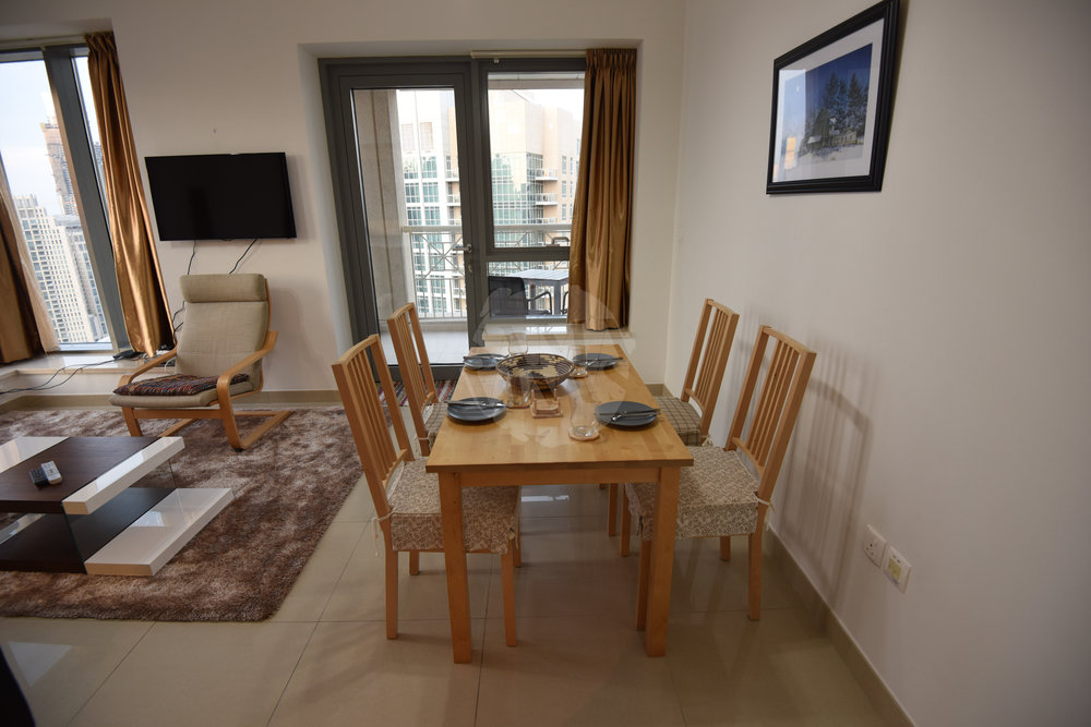 There is a dining table for you to enjoy meals or use as a workspace during your stay