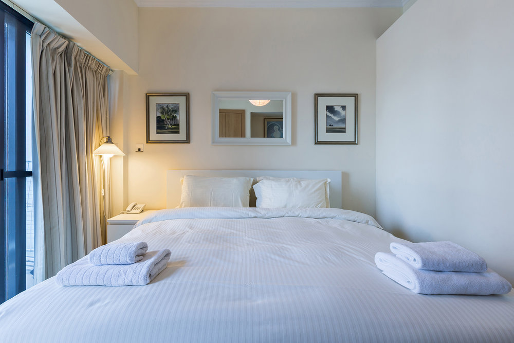 Extremely comfortable king size bed, partitioned from the rest of the studio for privacy.