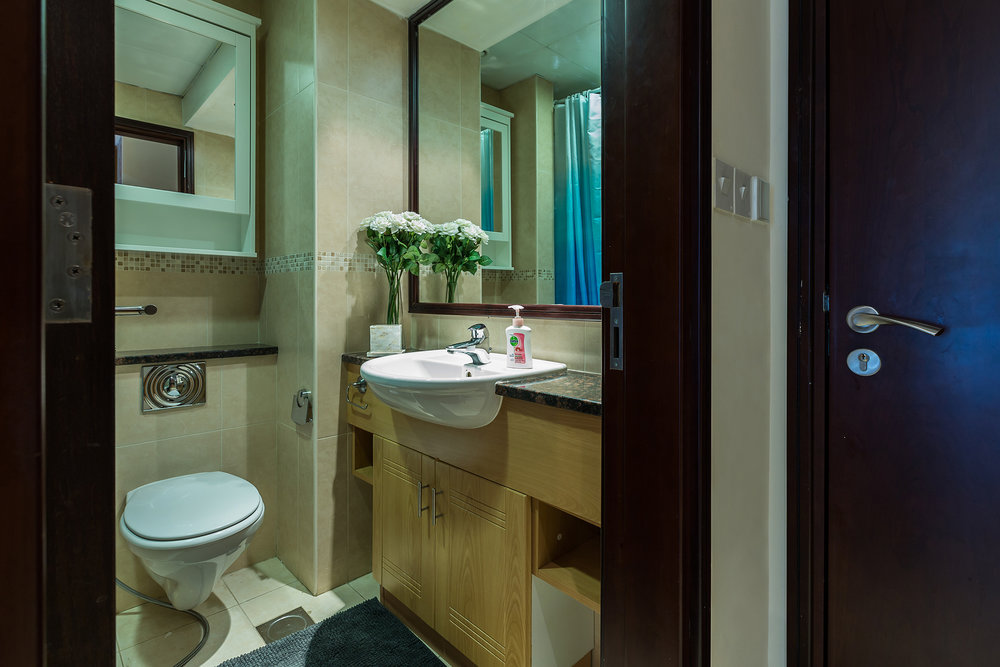 The bathroom is small but perfectly formed, with towels provided