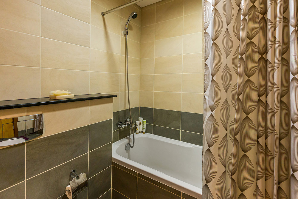 The bathroom offers all the amenities you will require during your stay
