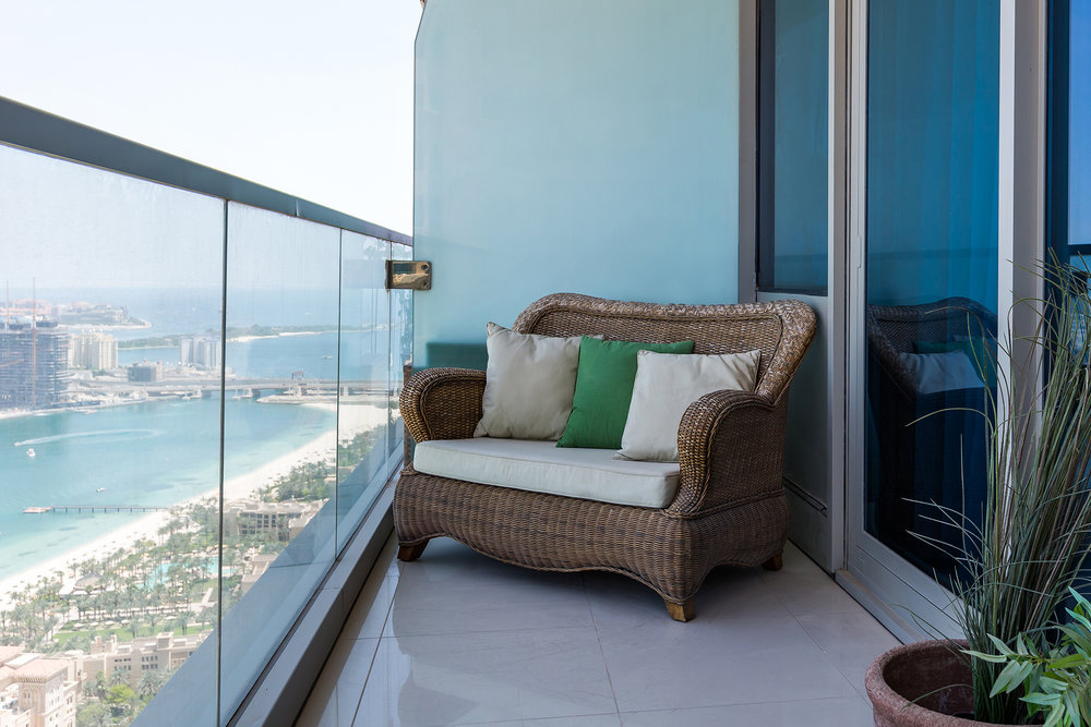 The huge balcony has both a dining and lounging area complete with breathtaking views overlooking the Palm Jumeirah