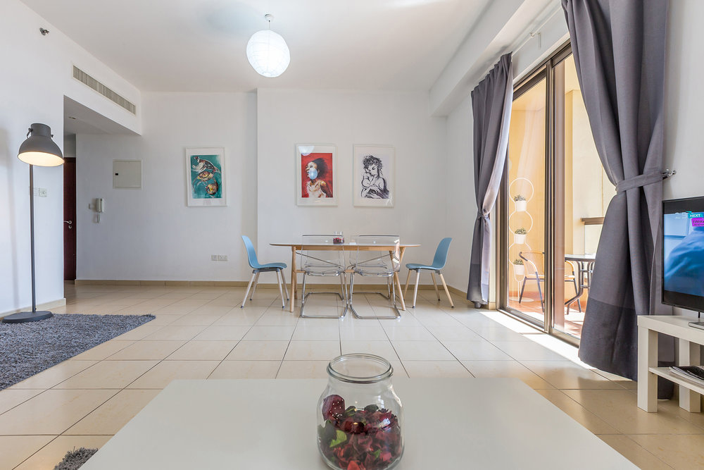 The spacious dining and living area is perfectly furnished for your needs
