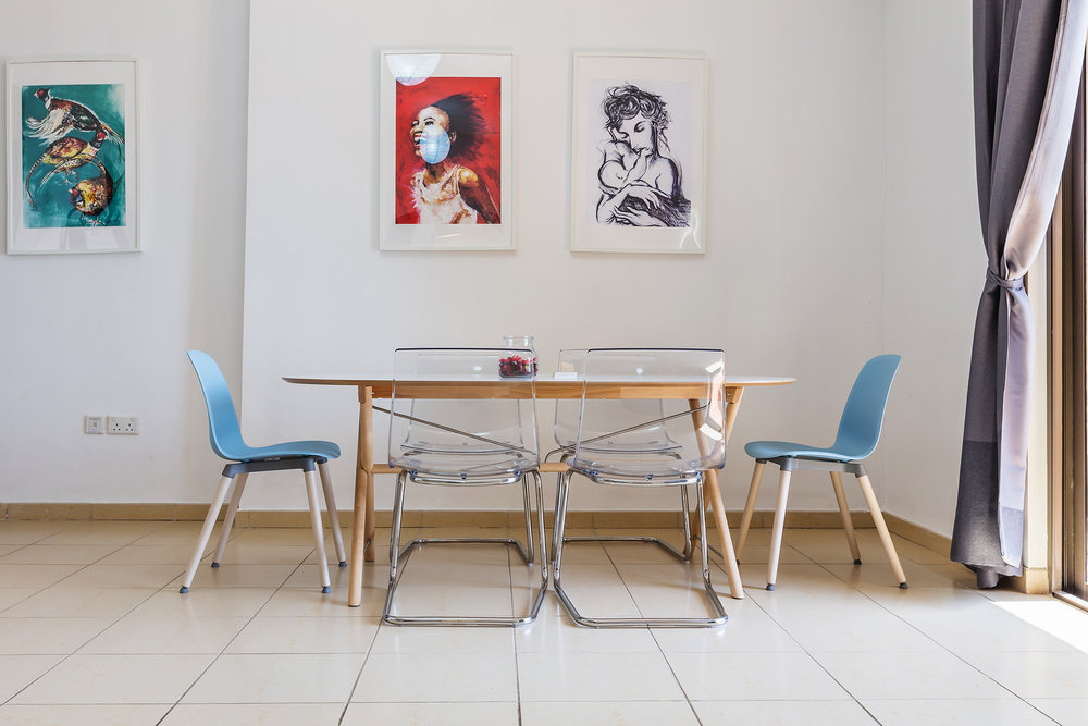 The dining table comfortably seats six, where you can open the door onto the balcony or sit surrounded by cool artwork