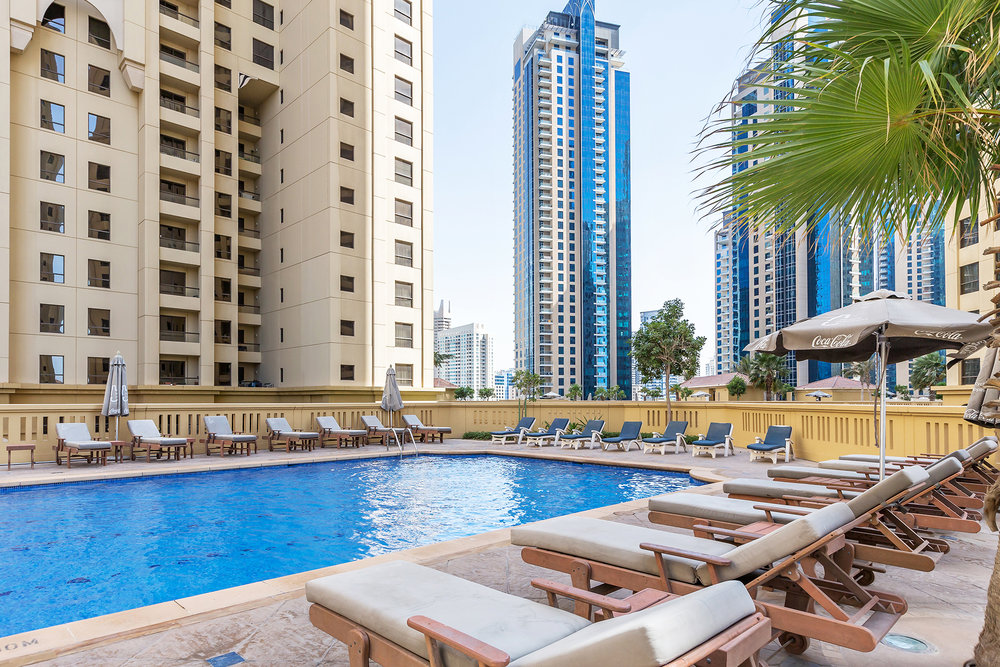 Each cluster of buildings has the choice of six swimming pools and a large, well-equipped community gym