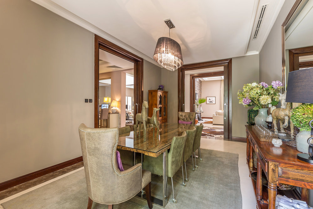 Large, luxurious formal dining area next to kitchen seating 8, leading on to the kitchen