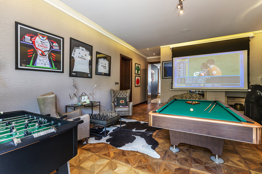 Games Room with full-szed pool table, Fuzzball and chess, and 3m HD projector. Opens out onto the garden bar