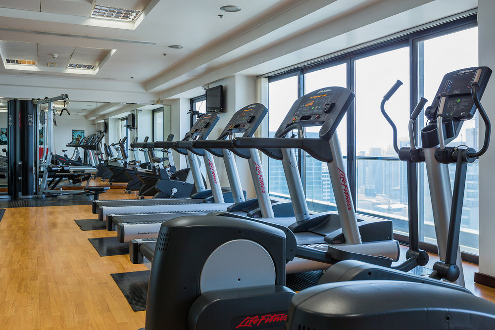 Fully equipped gym with majestic city view.