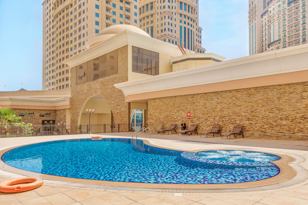 Enjoy the sun and dip in this pool and Jacuzzi