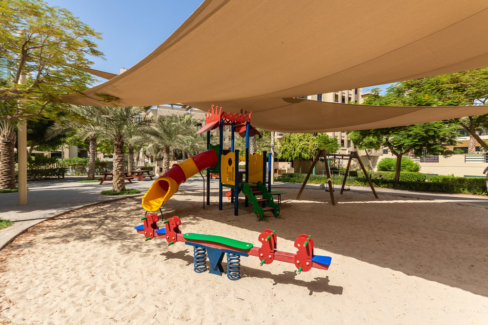 Playtime with kids in this spacious play area