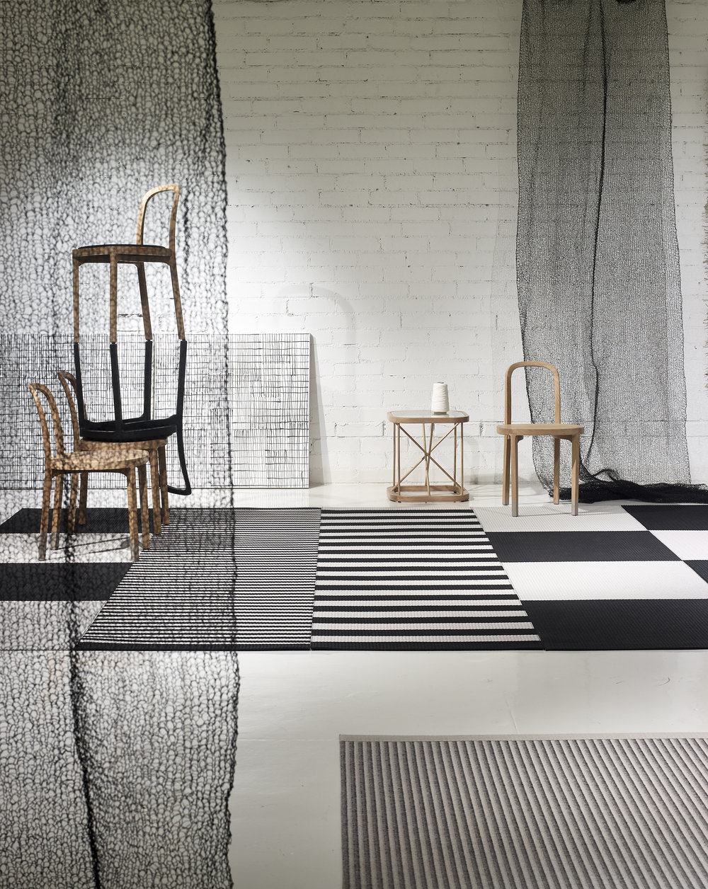 Woodnotes inspiration:  Squareplay  paper yarn carpets together with  Big Stripe  and Stripe carpets, 4400  Siro+  oak chairs, 46700W Twiggy table, Mesh hand knitted curtains.