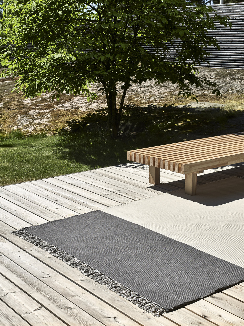 The  Woodnotes outdoor carpet  has a soft feel and is transpiring therefore ideal for leisure living. Outdoor Pond carpet col.graphite-pearl grey.