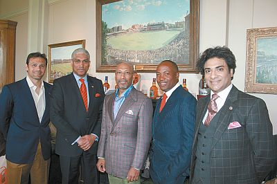 From left, Mark Ramprakash, T&T High Commissioner to London Garvin Nicholas, Andrew Ramroop, Brian Lara and Neil Latchman at the unveiling of Ramroop's Savile Row Collections.