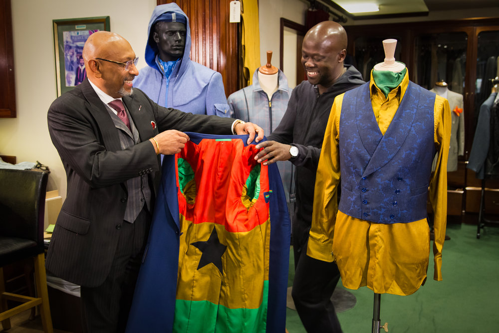Master Tailor Andrew Ramroop surprises David Adjaye OBE with a Ghanaian flag lining to his Ultra Bespoke suit created for his investiture with Her Majesty Queen Elizabeth.