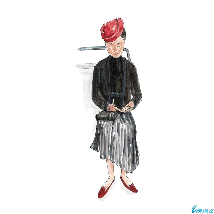 Fashionable Parisian metro rider with notebook