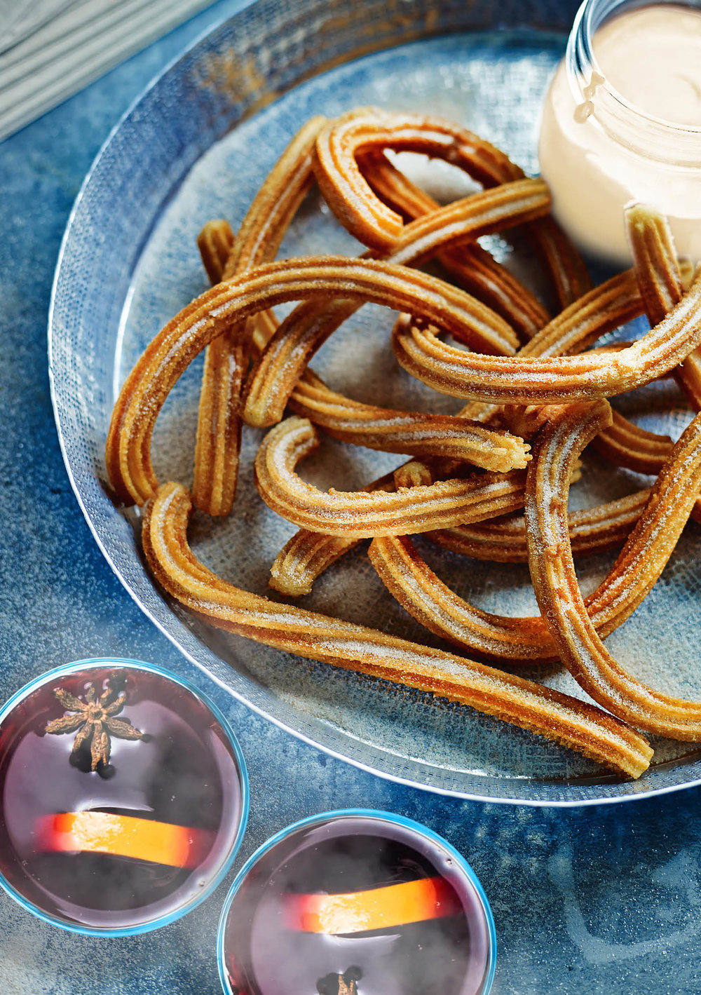 Christmas Churros with a turrón dipping sauce