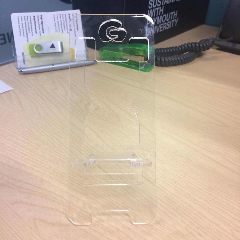 Jodine's sample clear Gummee Glove Smartstand from front.jpg
