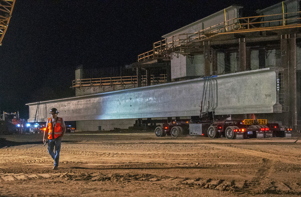 Setting two massive concrete girders over BNSF tracks in Madera County  ( Photo courtesy California High-Speed Rail Authority )