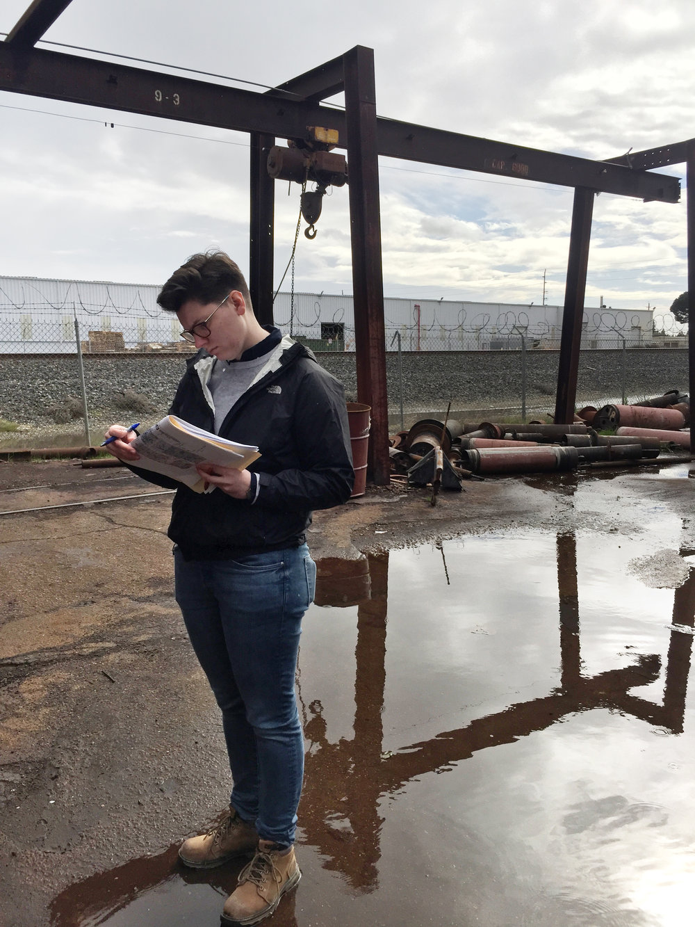Project Engineer Jake Less studies the facility's site map during discussion with client regarding sampling points.