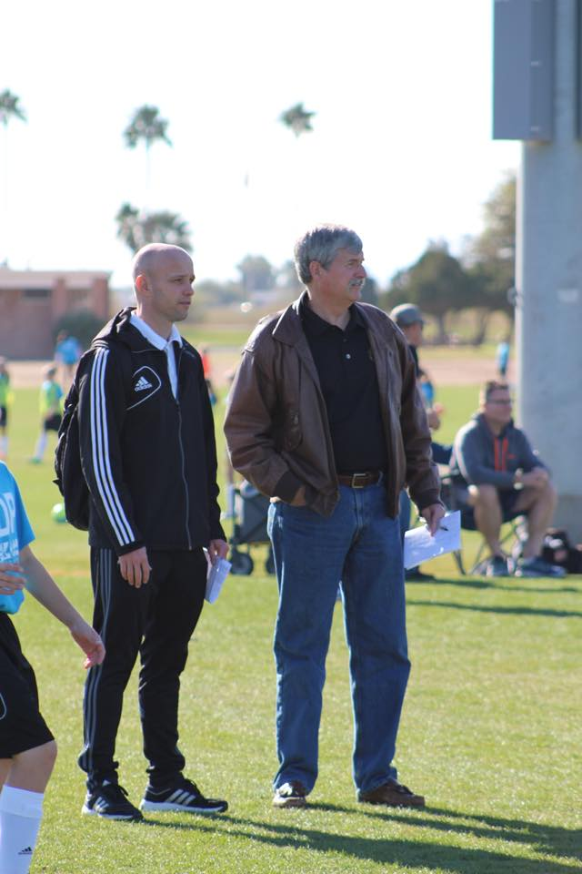 MLS Referee Alan Chapman (left) and State Assessor/Instructor Bob Barton observe referees working matches at the Development Academy.