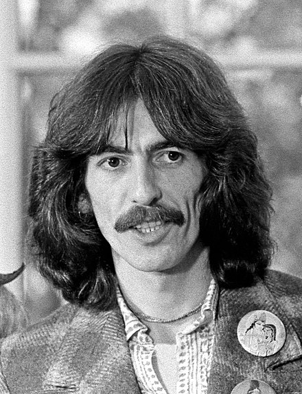 440px-George_Harrison_1974_edited.jpg