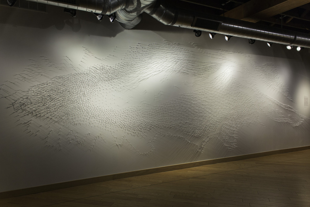 Murmuration I   Site Specific Installation at Indy Arts Council 924 Gallery   Honey Locust Thorns, T-Pins, White Paint   28' x 10' 2014