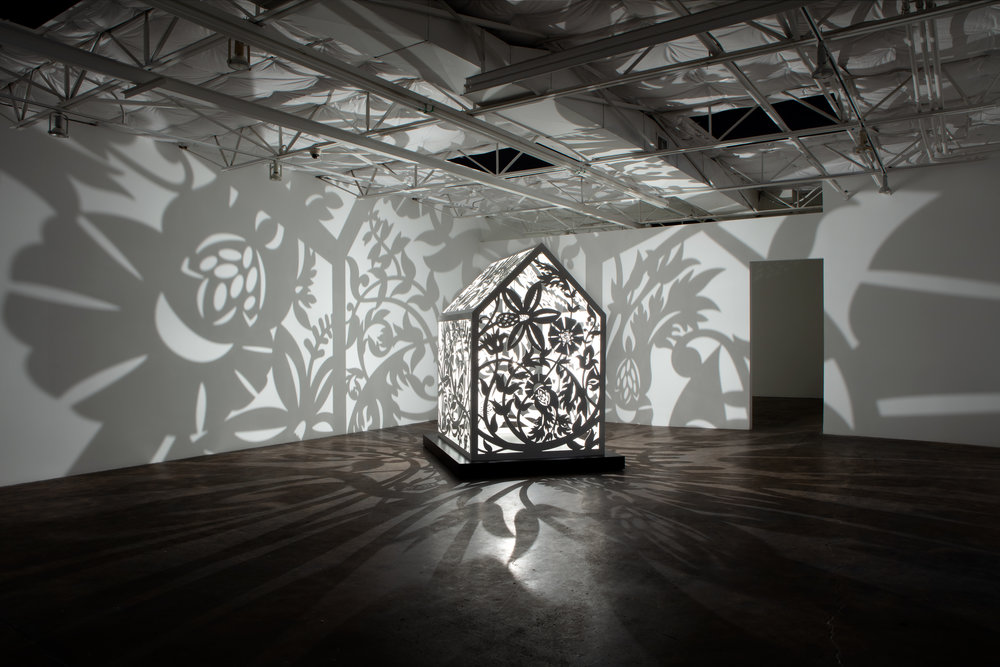 This is NOT a Refuge! 2  Installation at Talley Dunn Gallery, Dallas, TX, 2019    Laser-cut, Resin Coated Aluminum, Light Bulb  8' x 6' x 4'  This is NOT a Refuge! 2 Artist Statement