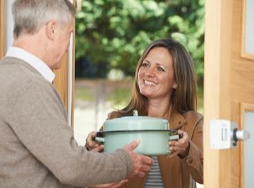 Woman-Bringing-Meal-For-Neighbor.jpg